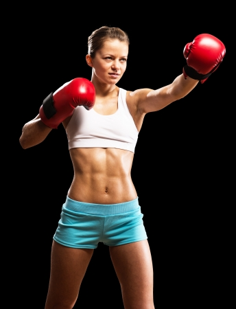 portrait of a woman boxer, aggressive and ready to fight photo