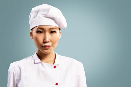 milk mustache: Asian woman chef drinking milk, milk mustache on her lips