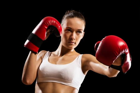 portrait of a woman boxer, aggressive and ready to fight Stock Photo