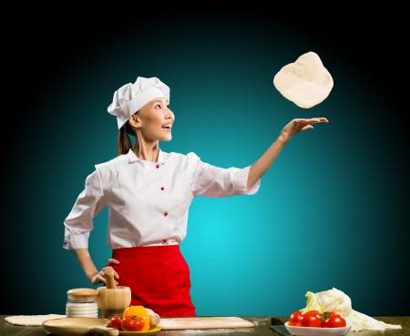 Chef throws a piece of dough for pizza photo