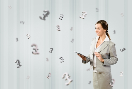 attractive business woman holding a tablet, financial concept Stock Photo - 17890324