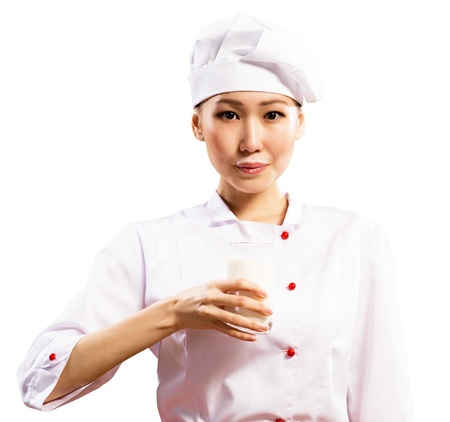 milk mustache: female asian chef holding a glass of milk, a milk mustache, isolated on white Stock Photo