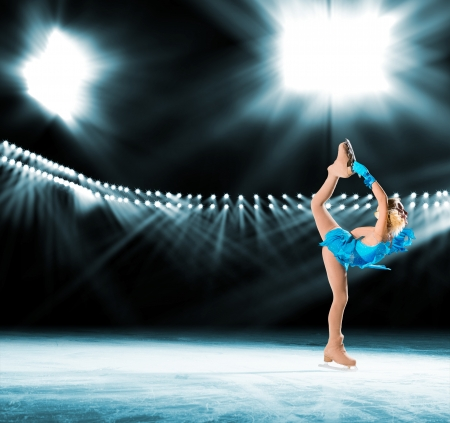 young skater performs on the ice in the background lights lighting Stock Photo - 18067158