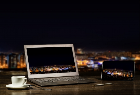 laptop and tablet, workplace businessman in the night city