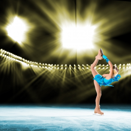 young skater performs on the ice in the background lights lighting photo