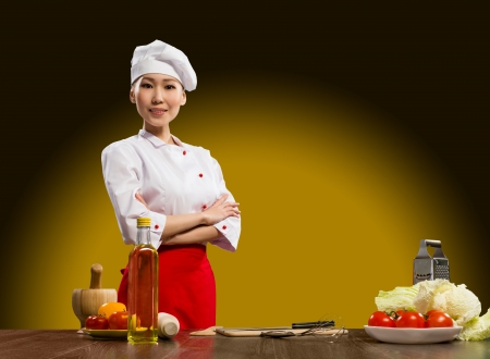 cook Asian woman standing with his arms crossed Stock Photo - 18497938
