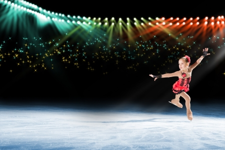 edge of the ice: young skater performs on the ice in the background lights lighting