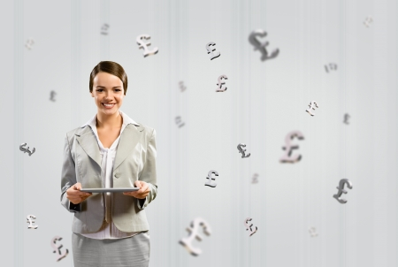 attractive business woman holding a tablet and smile, financial concept Stock Photo - 18623791