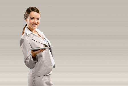 Business woman holding a touchpad, place for text photo