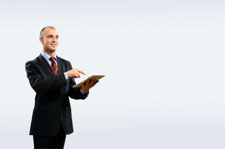 business man is working with the tablet, place for text photo