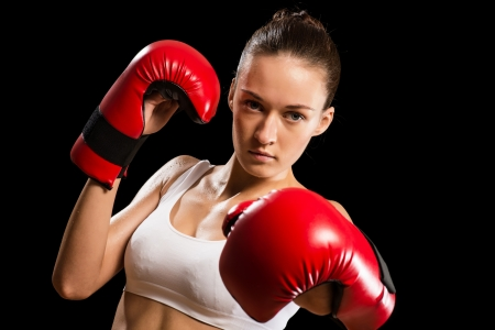 portrait of a woman boxer, aggressive and looks at the camera, close-up photo