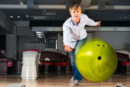 guy throws the ball, bowling, watching the ball flying photo