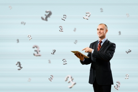man working with a Tablet PC, around the background of the pound sign, money concept photo