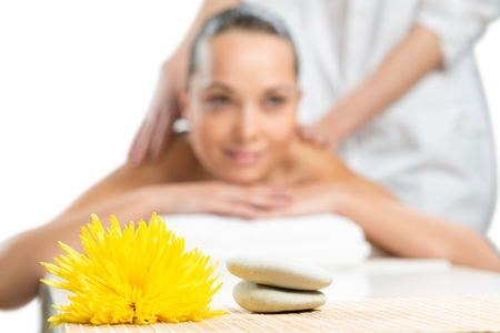 beautiful spa woman lying on the couch, in front of her flower and rolled towel Stock Photo - 19029234