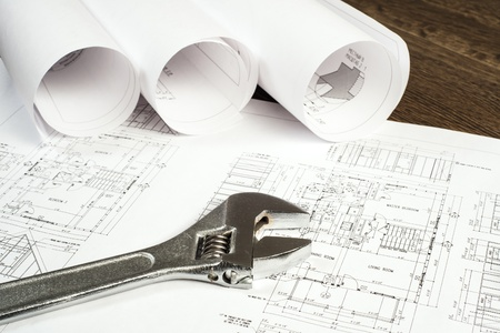 construction plans: wrench and drawings are on the desktop, workspace engineer Stock Photo