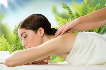 beautiful spa woman lying on a couch, female hands massaged Stock Photo - 19126112