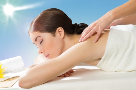 beautiful spa woman lying on a couch, female hands massaged Stock Photo - 19249044