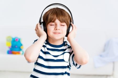keep your hands: boy in headphones enjoys music, Keep your hands on the headphones Stock Photo