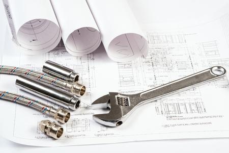 plumbing repair: plumbing and drawings are on the desktop, workspace engineer