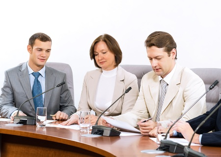 group of business people discussing documents, teamwork photo