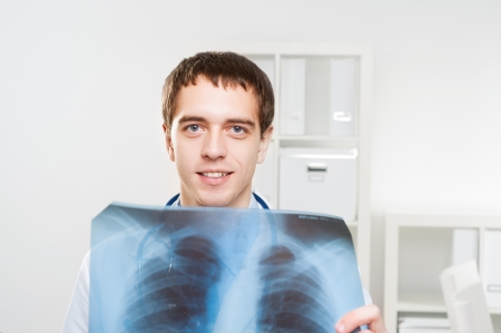 Doctor looking the x-ray picture of the chest photo