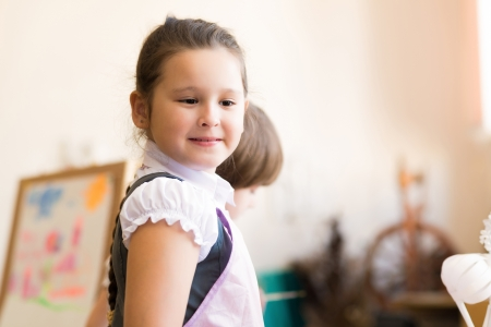 Portrait of Asian girl in apron interested in painting at an art school photo
