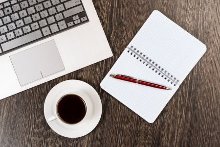 notebook, pen, coffee and tablet, workplace businessman photo