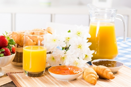 traditionally french: orange juice, croissants and strawberries still life