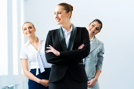 successful business woman in the office, colleagues stare over his shoulder