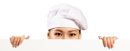 Asian female chef holding a white banner for text, hiding her face behind a poster photo