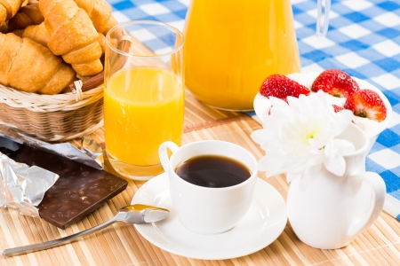 continental breakfast  coffee, strawberry with cream, croissant photo