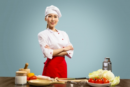 Portrait of Asian cooks, crossed her arms photo