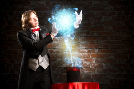 conjuror: magician makes passes at the cylinder, the cylinder produces magic Stock Photo