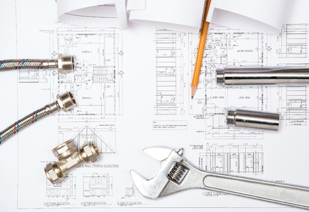 architectural detail: plumbing and drawings are on the desktop, workspace engineer