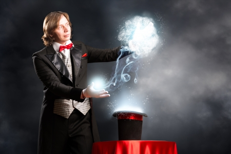light show: magician makes passes at the cylinder, the cylinder produces magic Stock Photo