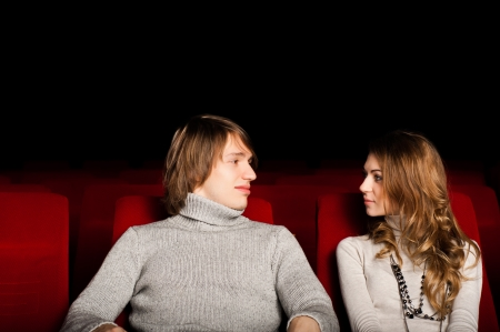 young couple in the cinema to enjoy the movie photo