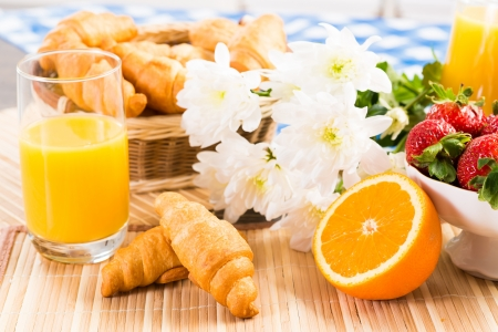 orange juice, croissants and strawberries photo