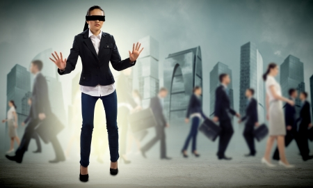 young blindfolded woman  seeking a way out in a crowd Stock Photo - 19908581
