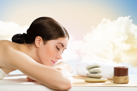 beautiful spa woman lying on the couch, gets pleasure Stock Photo - 19933556
