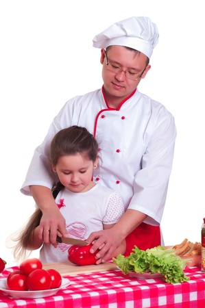 Father and daughter cooking a meal together photo