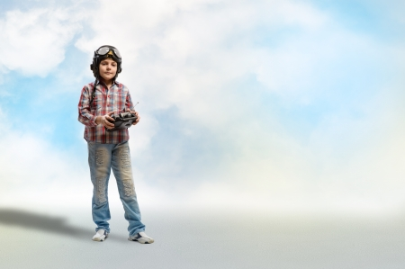 airman: Boy in helmet pilot radio remote control with the game