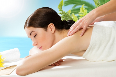 beautiful spa woman lying on a couch, female hands massaged Stock Photo - 20150990