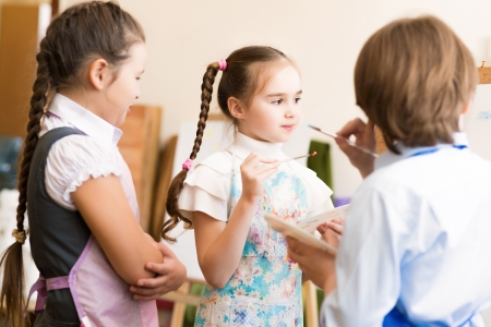 pre adult: children draw pictures of easels, drawing lesson Stock Photo