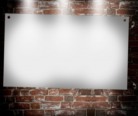 illuminated blank banner in the background of an old brick wall photo