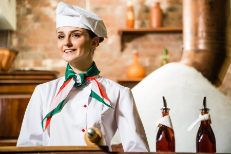 hotel staff: portrait of a cook, is on the traditional kitchen