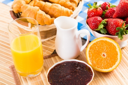 early breakfast, juice, croissants and jam, still life photo