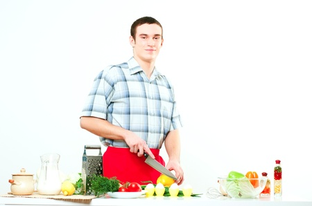 portrait of a man, cut vegetables, make meal photo