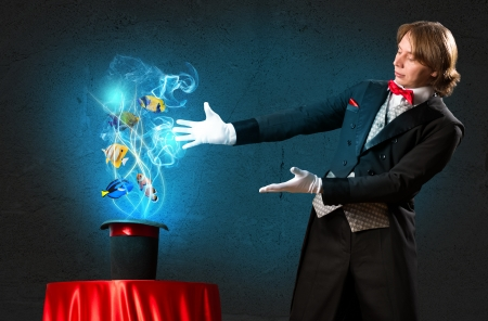 finger fish: magician casts a spell over the cylinder, circling around the colorful fish