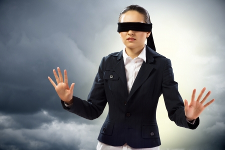 lucky man: young blindfolded woman  can not find a way out Stock Photo
