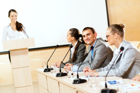 businessmen communicate at the conference, man looking at the camera photo